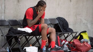 Toronto Raptors' Kawhi Leonard takes a phone call during a team practice in Burnaby, B.C. Wednesday, Sept. 26, 2018. THE CANADIAN PRESS Jonathan Hayward