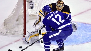 Toronto Maple Leafs centre Patrick Marleau (12) is stopped by Boston Bruins goaltender Tuukka Rask (40) during first period NHL round one playoff hockey action in Toronto on Thursday, April 19, 2018. THE CANADIAN PRESS/Frank Gunn