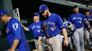 Toronto Blue Jays third baseman Russell Martin, center, walks out of the dugout after a baseball game against the Baltimore Orioles, Monday, Aug. 27, 2018, in Baltimore. (AP Photo/Patrick Semansky)