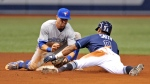 Toronto Blue Jays shortstop Richard Urena tags out Tampa Bay Rays' Mallex Smith at second base during the seventh inning of a baseball game Saturday, Sept. 29, 2018, in St. Petersburg, Fla. Smith hit an RBI-single and was thrown out by left fielder Teoscar Hernandez as he tried for the extra base. (AP Photo/Steve Nesius)