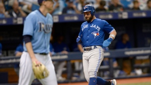 Toronto Blue Jays Kevin Pillar (11) scores on a Randal Grichuk (15) double during the third inning of a baseball game against the Tampa Bay Rays Sunday, Sept. 30, 2018, in St. Petersburg, Fla. (AP Photo/Jason Behnken)