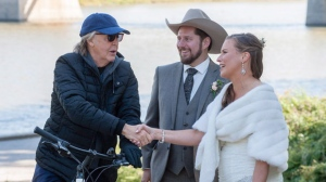 Paul McCartney greets newlyweds Steve Gregg and Jen Roscoe in Winnipeg in a handout photo. Roscoe and Gregg were getting their official wedding photos taken last Saturday alongside the Red River in Winnipeg when one of their friends noticed a guy passing by on a bicycle. It was McCartney, in Winnipeg for his current concert tour. THE CANADIAN PRESS/HO-Laurie Dixon and Tamara Large of Madix Photography