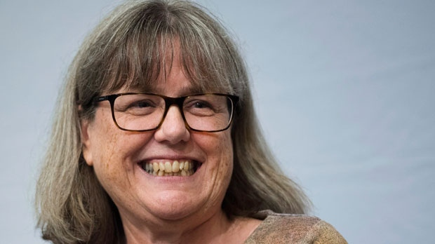 Noble Prize winner Donna Strickland smiles as she receives a standing ovation before speaking to the media during a press conference regarding her prestigious award in Waterloo, Ont., on Tuesday, Oct. 2, 2018. Strickland is among three physicists who were awarded the prize earlier today for groundbreaking inventions in the field of laser physics and also is one of only three women ever to win the Nobel Prize for physics, co-invented a method of generating high-intensity, ultra-short optical pulses which has a variety of applications, including corrective laser eye surgery. THE CANADIAN PRESS/Nathan Denette