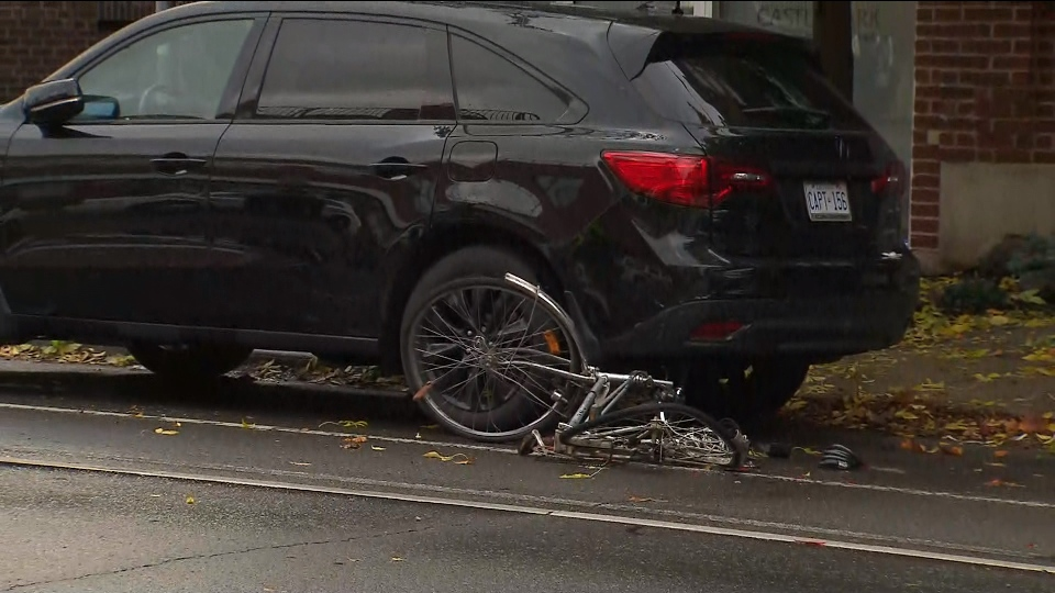 A female cyclist suffered severe head injuries after she was struck by a vehicle in Leslieville early Thursday morning.