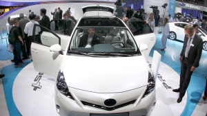 In this Sept. 13, 2011, file photo, new Toyota Prius hybrid car is presented during the press day of the 64th Frankfurt Auto Show in Frankfurt, Germany. Toyota Motor Corp. said Friday, Oct. 5, 2018, it has issued a recall for 2.43 million hybrid vehicles in Japan and elsewhere for problems with stalling. (AP Photo/Michael Probst, File)