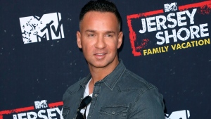 "In this March 29, 2018 file photo, Mike ""The Situation"" Sorrentino arrives at the ""Jersey Shore Family Vacation"" premiere in Los Angeles. Sorrentino is seeking probation when he's sentenced Friday on tax charges, while prosecutors want a sentence of 14 months. Sorrentino pleaded guilty in January to concealing his income in 2011 by making cash deposits that wouldn't trigger federal reporting requirements. He and his brother were charged in 2014 with multiple tax offenses related to nearly $9 million in income. (Photo by Willy Sanjuan/Invision/AP, File)"