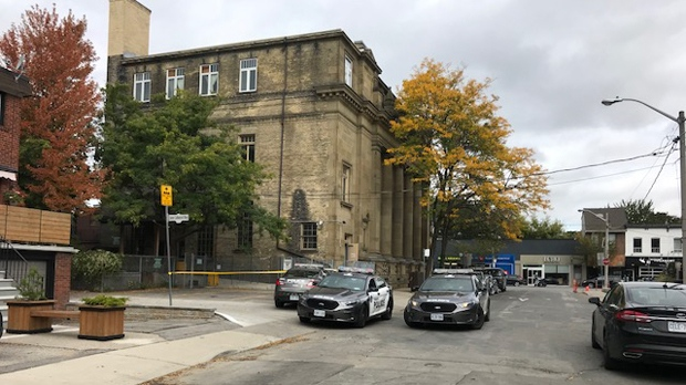 Police vehicles are seen outside June Callwood Way after a deceased male was found there on Oct. 5, 2018. (Keith Hanley/CTV News Toronto)