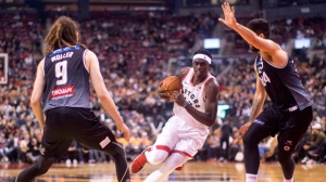 Toronto Raptors' Pascal Siakam, centre, drives to the net as Melbourne United's Tohi Smith-Milner, right, and Craig Moller defend during first half exhibition basketball action in Toronto on Friday, October 5, 2018. THE CANADIAN PRESS/Chris Young
