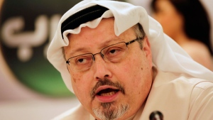 Saudi journalist Jamal Khashoggi speaks during a press conference in Manama, Bahrain, Feb. 1, 2015. (AP Photo/Hasan Jamali)