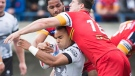 Toronto Wolfpack forward Mason Caton-O'Brien, left, gets tackled by London Broncos MattyGee, right, during first half rugby league action in Toronto on Sunday, October 7, 2018. THE CANADIAN PRESS/Nathan Denette