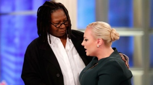 """This image released by ABC shows co-host Meghan McCain right, being comforted by fellow co-host Whoopi Goldberg during her first appearance on """"The View,"""" in New York, Monday, Oct. 8, 2018, since the death of her father. Sen. John McCain in August. McCain thanked viewers and her colleagues for their support. (Lou Rocco/ABC via AP)"""