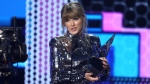 "Taylor Swift accepts the award for favorite pop/rock album for ""Reputation"" at the American Music Awards on Tuesday, Oct. 9, 2018, at the Microsoft Theater in Los Angeles. (Photo by Matt Sayles/Invision/AP)"