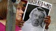 People hold signs during a protest at the Embassy of Saudi Arabia about the disappearance of Saudi journalist Jamal Khashoggi, Wednesday, Oct. 10, 2018, in Washington. (AP Photo/Jacquelyn Martin)