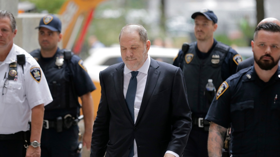 Harvey Weinstein, center, arrives to court in New York, Thursday, Oct. 11, 2018. Weinstein is set to appear before a judge as his lawyers try to get the charges dismissed in his criminal case.(AP Photo/Seth Wenig)