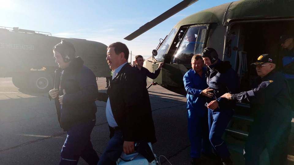 In this photo provided by Russian Defense Ministry Press Service, Russian cosmonaut Alexey Ovchinin, left, and NASA astronaut Nick Hague, second from right, are evacuated by the rescue team after an emergency landing near Dzhezkazgan, about 450 kilometers (280 miles) northeast of Baikonur, Kazakhstan, Thursday, Oct. 11, 2018. NASA astronaut Nick Hague and Roscosmos' Alexei Ovchinin lifted off as scheduled at 2:40 p.m. (0840 GMT; 4:40 a.m. EDT) Thursday from the Russian-leased Baikonur cosmodrome in Kazakhstan, but their Soyuz booster rocket failed about two minutes after the launch. (Russian Defense Ministry Press Service photo via AP)