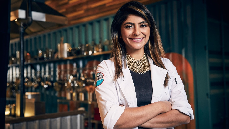 "This May 9, 2017 photo released by Bravo shows cooking contestant Fatima Ali during season 15 of the competition series, ""Top Chef,"" in Denver. (Tommy Garcia/Bravo via AP)"