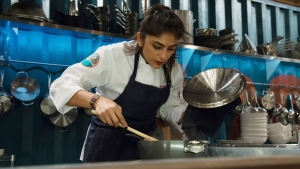 """This May 7, 2017 photo released by Bravo shows cooking contestant Fatima Ali during season 15 of """"Top Chef,"""" in Denver. Ali says she has a year to live. (Paul Trantow/Bravo via AP)"""