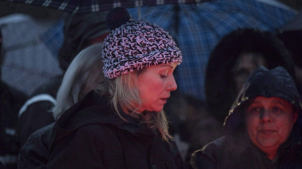 Michelle Hanson attends a vigil for her son Kaden Young in Belwood, Ont., Wednesday, April 25, 2018. Police say they've now charged Young's mother, Michelle Hanson, with impaired driving causing death, dangerous driving causing death, and criminal negligence causing death. THE CANADIAN PRESS/Chris Young