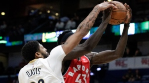 New Orleans Pelicans forward Anthony Davis (23) blocks a shot by Toronto Raptors forward Pascal Siakam (43) during the first half of a preseason NBA basketball game in New Orleans, Thursday, Oct. 11, 2018. (AP Photo/Scott Threlkeld)