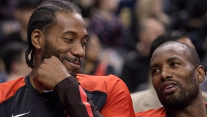 Toronto Raptors Kawhi Leonard, left, sits on the bench with Serge Ibaka during second half exhibition basketball action against Melbourne United, in Toronto on Friday, October 5, 2018. THE CANADIAN PRESS/Chris Young