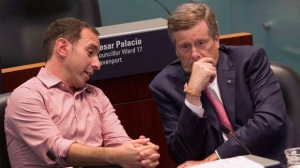 Toronto Mayor John Tory (right) sits with Councillor Josh Matlow in the Council Chamber at Toronto City Hall, on Thursday September 13, 2018 as council sits to discuss the Ontario Government's introduction of legislation to reduce the size of Toronto City Council . THE CANADIAN PRESS/Chris Young