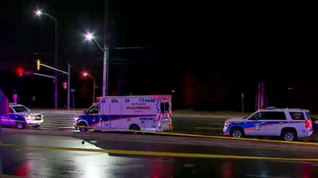 Emergency crews are seen at the scene of a fatal crash in Brampton that left a male pedestrian dead.