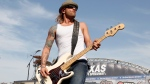 In this April 9, 2011 file photo, 3 Doors Down' bassist Todd Harrell performs before a NASCAR auto race at Texas Motor Speedway in Fort Worth, Texas. Harrell, the founding member and former bassist of the rock band 3 Doors Down has been sentenced to 10 years in Mississippi state prison for possession of a firearm by a felon. News outlets report Jackson County Circuit Court Judge Robert Krebs gave Todd Harrell the maximum penalty during a hearing Thursday, Oct. 11, 2018. (AP Photo/Tim Sharp, File)