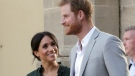 FILE - In this file photo dated Wednesday, Oct. 3, 2018, Britain's Prince Harry, right, and Meghan, Duchess of Sussex visit the Pavilion Building in Brighton, England. Kensington Palace announced Monday Oct. 15, 2018, that Prince Harry and his wife the Duchess of Sussex are expecting a child in spring 2019. (AP Photo/Tim Ireland, FILE)