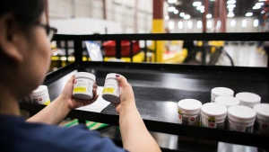 A worker examines cannabis products at the Ontario Cannabis Store distribution centre in an undated handout photo. THE CANADIAN PRESS/HO-Ontario Cannabis Store.