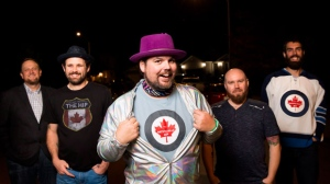 The Artificially Hip, a Tragically Hip tribute band, from left, Simon McIntyre, Mat Bowman, William Bishop, Dave Guenard and Brad Rigby pose for a photo Thursday, October 11, 2018 outside of their rehearsal space in Cambridge, Ont. THE CANADIAN PRESS/Tara Walton