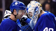 Toronto Maple Leafs centre John Tavares (91) and goaltender Garret Sparks (40) celebrate after defeating the Los Angeles Kings in NHL hockey action in Toronto on Monday, October 15, 2018. THE CANADIAN PRESS/Nathan Denette