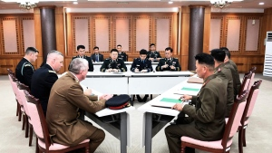 In this photo provided by South Korea Defense Ministry, the U.S.-led United Nations Command, left, South Korean and North Korean, right, military officers attend a meeting at the southern side of Panmunjom in the Demilitarized Zone, South Korea, Tuesday, Oct. 16, 2018. The rival Koreas and the U.S.-led United Nations Command were meeting Tuesday to discuss efforts to disarm a military zone the rivals control within their shared border under a peace agreement between the Koreas. (South Korea Defense Ministry via AP)