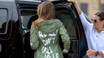 FILE - In this June 21, 2018, file photo, First lady Melania Trump arrives at Andrews Air Force Base, Md., wearing a jacket that reads 'I REALLY DON'T CARE, DO U?' after visiting a children's center in McAllen, Texas. A Melania Trump spokeswoman is asking people to boycott Atlanta rapper T.I. because of his promotional album video that shows a woman resembling the first lady stripping in the oval office. WXIA-TV reports the director of communications for Melania Trump, Stephanie Grisham, tweeted Saturday asking how the video was acceptable. (AP Photo/Andrew Harnik, File)