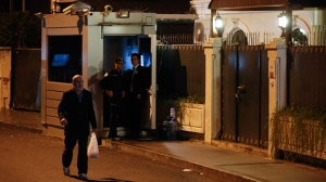 A man walks past the Saudi Arabia consul's residence, in Istanbul, Tuesday, Oct. 16, 2018. A high-level Turkish official says police who searched the Saudi Consulate in Istanbul found evidence that Saudi writer Jamal Khashoggi was killed there. Authorities meanwhile prepared to search the consul's residence nearby after the diplomat left the country. State media say security forces began setting up barricades in front of the residence just hours after Consul Mohammed al-Otaibi flew out of the country on a 2 p.m. flight. (AP Photo/Emrah Gurel)
