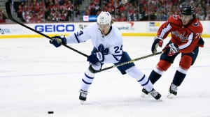 Toronto Maple Leafs right wing Kasperi Kapanen (24), of Finland, chases the puck against Washington Capitals right wing T.J. Oshie (77) during the first period of an NHL hockey game, Saturday, Oct. 13, 2018, in Washington. (AP Photo/Nick Wass)