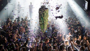 A depiction of a cannabis bud drops from the ceiling at Leafly's countdown party in Toronto on Wednesday, Oct. 17, 2018, as midnight passes and marks the first day of the legalization of cannabis across Canada. (Chris Young/The Canadian Press via AP)