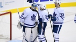 Toronto Maple Leafs left wing Josh Leivo (32), center Frederik Gauthier (33) and goaltender Frederik Andersen (31), of Denmark, celebrate after an NHL hockey game against the Washington Capitals, Saturday, Oct. 13, 2018, in Washington. The Maple Leafs won 4-2. (AP Photo/Nick Wass)