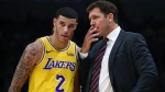 Los Angeles Lakers coach Luke Walton, right, speaks to Lonzo Ball (2) during the second half of the team's preseason NBA basketball game against the Golden State Warriors on Friday, Oct. 12, 2018, in San Jose, Calif. (AP Photo/Ben Margot)