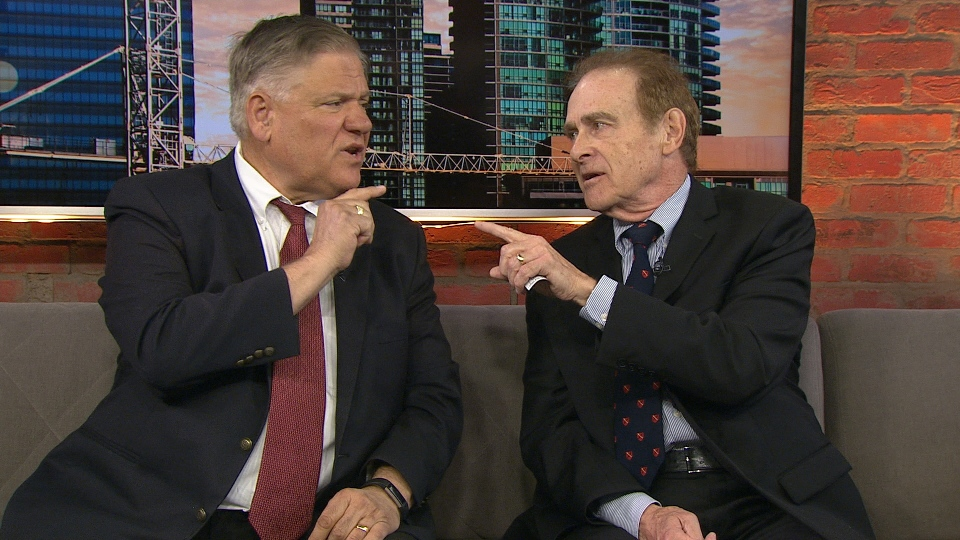 Ward 22 candidates Norm Kelly and Jim Karygiannis point at each other during a heated exchange as they both vie to represent the new Ward 22 on Toronto City Council.