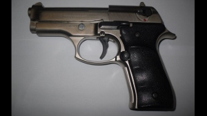 A loaded handgun seized on Oct. 16, 2018, is shown in a handout image from Toronto police.