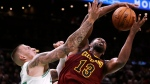 Cleveland Cavaliers forward Tristan Thompson (13) grabs a rebound against Boston Celtics forward Daniel Theis, left, during the second quarter of an NBA basketball game in Boston on October 2, 2018. Tristan Thompson credits his stint with Canada's national basketball team this past summer for his solid NBA training camp. The 27-year-old from Brampton, Ont., helped the Canadians to an 85-77 victory over Brazil in a World Cup qualifying game Sept. 13 in Laval, Que., then reported for Cleveland's camp less than a week later. THE CANADIAN PRESS/AP, Charles Krupa