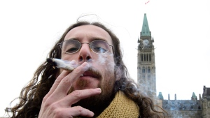 George Matias from Brazil smokes a marijuana joint on Parliament Hill in Ottawa on Wednesday, Oct. 17, 2018. Canada legalized cannabis nation wide today. THE CANADIAN PRESS/Sean Kilpatrick