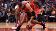 Toronto Raptors centre Jonas Valanciunas (17) battles Cleveland Cavaliers forward Tristan Thompson (13) for the loose ball during second half NBA basketball action in Toronto on Wednesday, October 17, 2018. THE CANADIAN PRESS/Nathan Denette