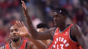 Toronto Raptors forward Kawhi Leonard, left, celebrates a basket with teammate forward Pascal Siakam (43) against the Cleveland Cavaliers during second half NBA basketball action in Toronto on Wednesday, October 17, 2018. THE CANADIAN PRESS/Nathan Denette