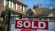 A sold sign is seen outside of a home in this file image.