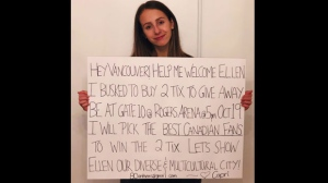 Capri Everitt holds a sign as she poses in this recent handout photo. Fourteen-year-old Capri Everitt of Vancouver bought two tickets to Ellen Degeneres's performance in Vancouver with money she'd earned busking. She planned to give them away to fans based on their singing of O Canada outside Rogers Arena tomorrow night before show time. But then she was given 80 tickets to give away. THE CANADIAN PRESS/HO - Capri Everitt