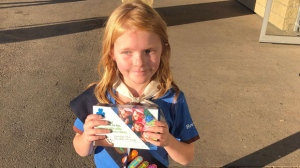 Nine-year-old Elina Childs poses as she sells Girl Guide Cookies outside a cannabis store in Edmonton on Wednesday, Oct. 17, 2018 in this handout photo. She's being called one smart cookie. As people lined up to buy marijuana at one of six Edmonton cannabis stores that opened Wednesday, there was a small entrepreneur in the crowd. Nine-year-old Elina Childs had a wagon full of Girl Guide cookies for sale. THE CANADIAN PRESS/HO - Seann Childs