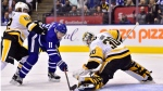 Toronto Maple Leafs centre Zach Hyman (11) is stopped by Pittsburgh Penguins goaltender Matt Murray (30) as Pittsburgh Penguins left wing Carl Hagelin (62) defends during second period NHL hockey action in Toronto on Thursday, October 18, 2018. THE CANADIAN PRESS/Frank Gunn