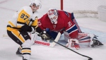 Montreal Canadiens goaltender Antti Niemi makes a save against Pittsburgh Penguins' Sidney Crosby during shootout NHL hockey action in Montreal, Saturday, October 13, 2018. THE CANADIAN PRESS/Graham Hughes