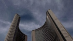 RCAF aircraft fly past City Hall during a ceremony in which the Royal Canadian Air Force were presented with new ceremonial flags in Toronto on Friday, September 1, 2017. THE CANADIAN PRESS/Chris Young